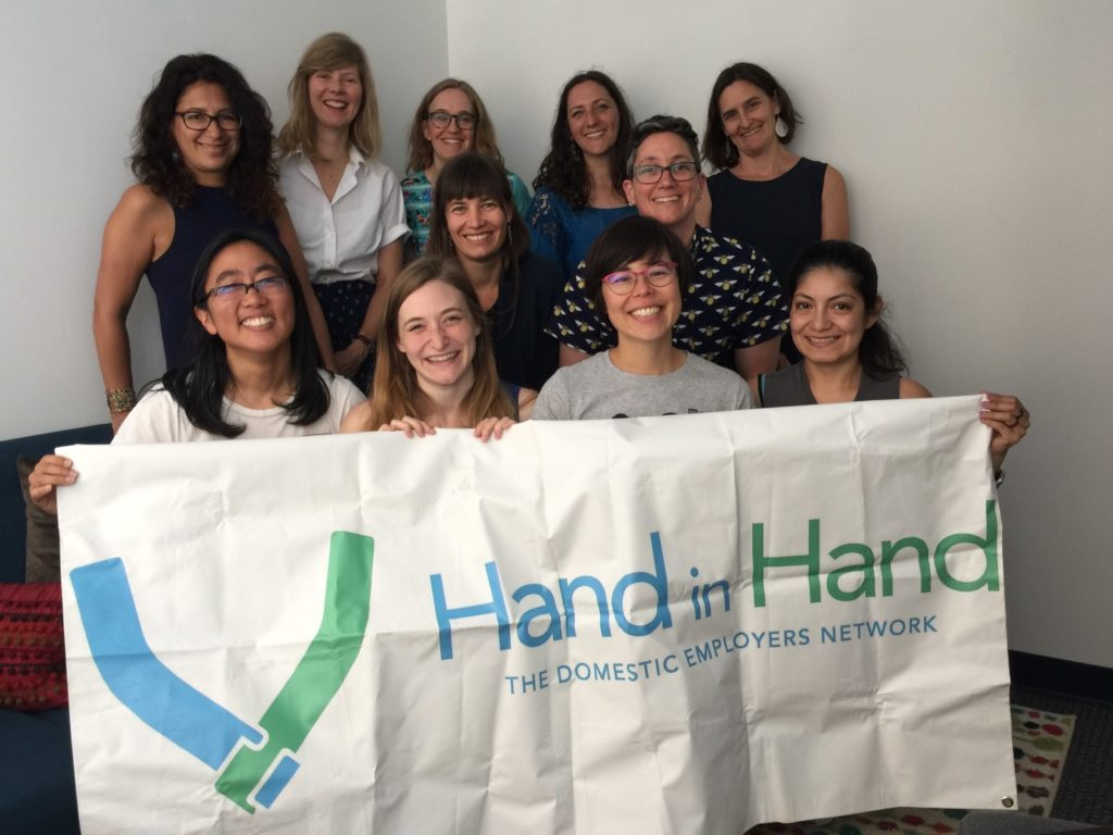 Photo of staff holding Hand in Hand banner
