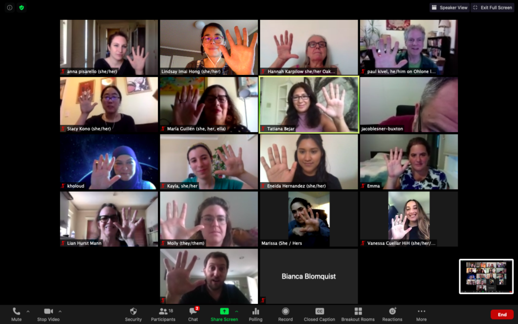 Grid of people holding up zoom call during zoom meeting